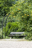 Green gazebos with bench in garden Royalty Free Stock Photo