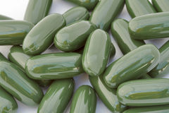 Green gelatinous capsules background Royalty Free Stock Images
