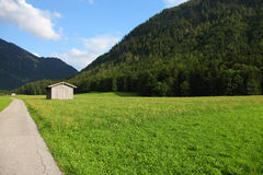 Green Germany. This is the way in german Bavaria to the mountain. right side is a nice meadow and blue sky in the background. the village is called Rottach Egern Royalty Free Stock Images