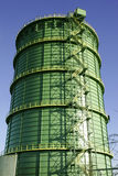 Green giant. A big green gasholder near the town Herne, Germany stock photography