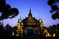 The Green Giant and White Giant at Wat Arun stock photo