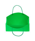 Green gift bag falls through the air Royalty Free Stock Photos
