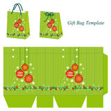 Green gift bag template with Christmas balls. Christmas gift box with Christmas decoration, sparkles and snowflakes stock illustration
