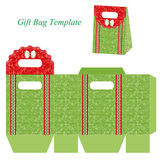 Green gift bag template with floral pattern and ribbon Stock Photos