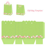 Green gift bag template with stripes and flowers Stock Photos