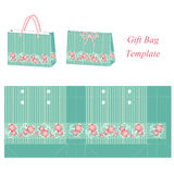 Green Gift bag template with stripes and pink flowers Royalty Free Stock Images