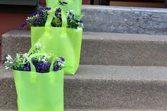 Green gift bags with flowers Royalty Free Stock Photos