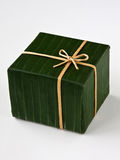 Green gift box. Gift box wrapped with banana leaf, ribbon and rope made from banana bark Stock Photography