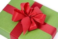 Green gift box. With red ribbons. White background Stock Photo