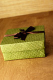Green Gift Box. Green gift with brown ribbon Stock Image