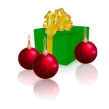 Green gift box with gold ribbon. And bow and Christmas balls isolated on white background Royalty Free Stock Photos