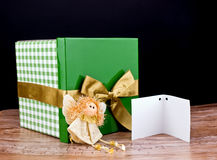 Green gift box with golden bow Stock Photos