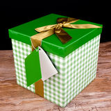 Green gift box with golden bow Stock Photo