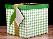 Green gift box with golden bow Royalty Free Stock Images