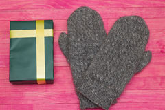 Green gift box  and mittens Stock Images