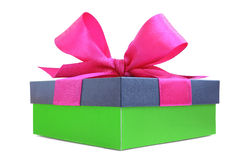 Green gift box with pink satin ribbon bow Stock Photo