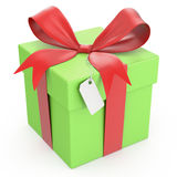 Green gift box with a price tag Stock Photography