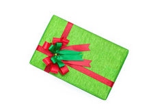 Green gift box with Red and green ribbons bow. On white backgound Stock Photo
