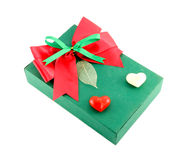 Green gift box with red ribbon Stock Image