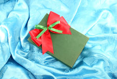 Green gift box with red ribbon Royalty Free Stock Photography