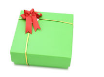 Green gift box with red ribbon bow Royalty Free Stock Images