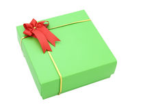 Green gift box with red ribbon bow Royalty Free Stock Photography