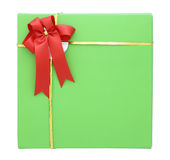 Green gift box with red ribbon bow Stock Images