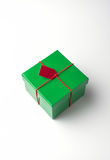 Green gift box with red tag Stock Photo