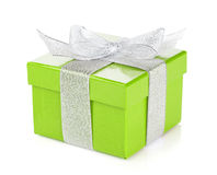 Green gift box with silver ribbon and bow Royalty Free Stock Photos