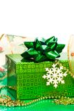 Green gift box and snowflake Stock Photography
