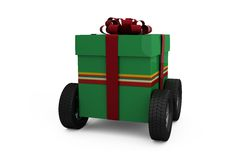 Green gift box with wheels Royalty Free Stock Photo