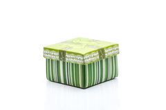 A green gift box with white strip Royalty Free Stock Image