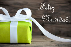 Green Gift with Feliz Navidad. Green Present with the Spanish Words Feliz Navidad, which means Merry Christmas, on Wooden Background stock photos