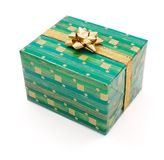 Green gift with golden bow Stock Images