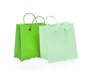 Green gift packages standing in the snow Royalty Free Stock Photos