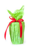 A green gift with a red ribbon and a bow. Isolate on white background Stock Images