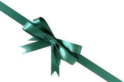 Green gift ribbon bow corner diagonal isolated on white background Stock Photos