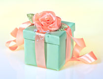 Green gift with rose ribbon Royalty Free Stock Images