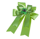 Green gift satin ribbon bow. On white background Royalty Free Stock Images