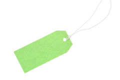 Green gift tag with cotton thread royalty free stock image