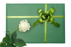 Green gift with white rose Stock Images