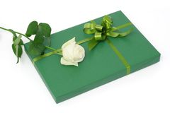 Green gift with white rose Royalty Free Stock Images
