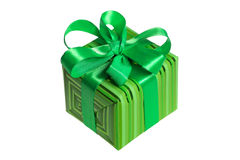 Green gift wrapping. Green gift  wrapped in wrapping paper closed with ribbon and topped with a decorative bow Stock Photo