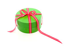 A green giftbox with a red ribbon Royalty Free Stock Images