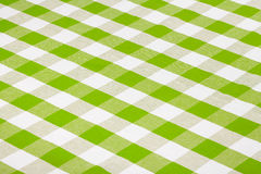 Green gingham checkered tablecloth. Green kitchen checkered table cloth Royalty Free Stock Image