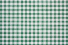 Green Gingham tablecoth background. Green gingham tablecloth often found in diners and cafes a popular traditional covering for tables where food is consumed Royalty Free Stock Images