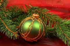 Green glass ball in Christmas wreath Stock Photo