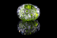 Green glass bead with bubbles Stock Photography
