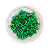 Green glass beads in small dish. Royalty Free Stock Photos