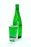 Green glass bottle with mineral water ,  on white backgr Royalty Free Stock Images